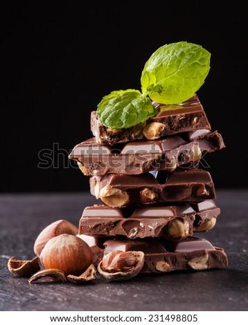 Pile of hazelnut chocolate isolated on black background - stock photo