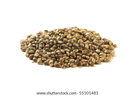 Pile of hemp seeds isolated on white background. Vegetarian Food.