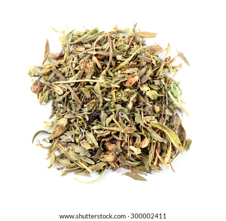 Pile of herbal tea isolated on white - stock photo
