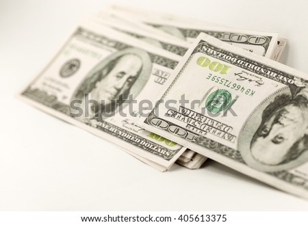 pile of hundred dollar bill on a white background