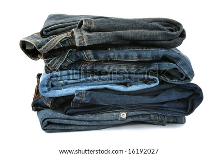 pile of jeans isolated on white background - stock photo