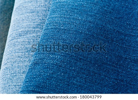 Pile of jeans of various shades of blue - stock photo