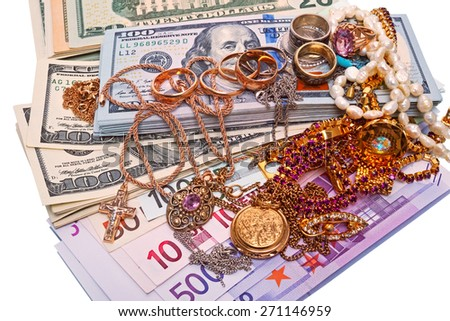 Pile of jewelry and currency isolated on white background - stock photo