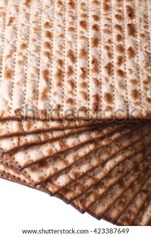 Pile of Jewish kosher matzah macro isolated on white background vertical - stock photo