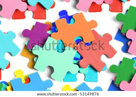 Pile of Jigsaw Puzzle Pieces on White Background