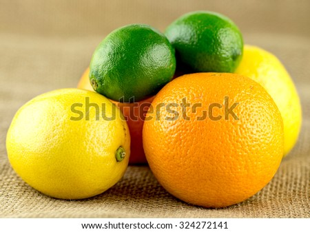 Pile of juicy citrus fruits with limes, lemons and oranges - stock photo