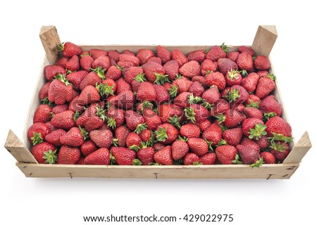 Pile of juicy ripe organic strawberries in a wooden box, crate, on a white background - stock photo