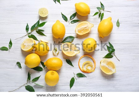 Pile of lemons on wooden table - stock photo