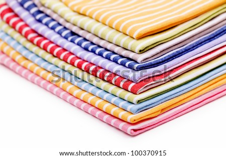 Pile of linen kitchen towels - stock photo