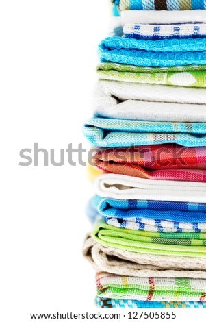 Pile of linen kitchen towels isolated on white background - stock photo