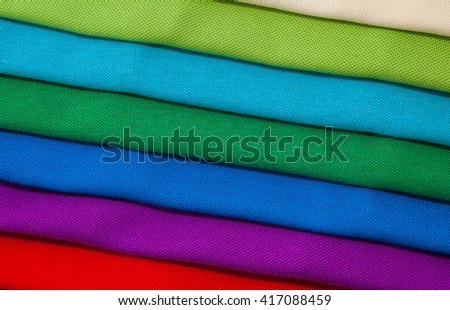 Pile of luxurious fine material 100% cotton polo shirts in various colors