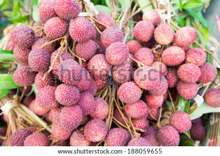 pile of lychee for sale in local market - stock photo