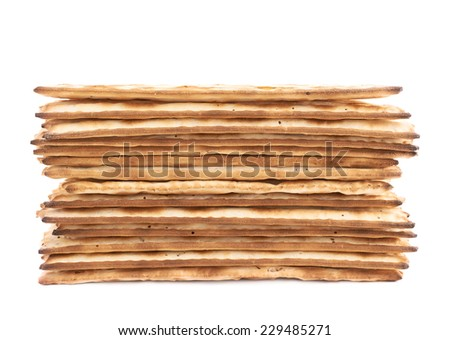 Pile of machine made matza flatbread, composition isolated over the white background - stock photo