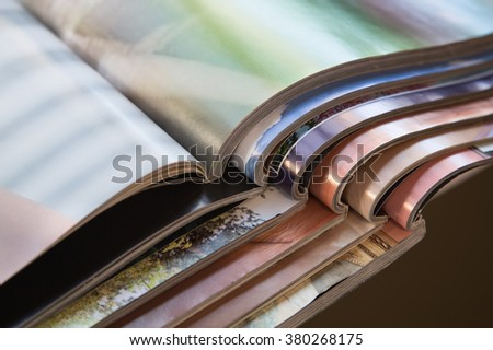pile of magazines - colorful - stock photo