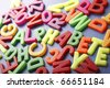 "Pile of magnetic letters with the hidden word ""Alphabet"" - stock photo"