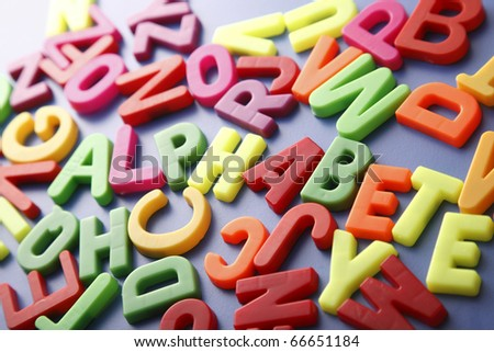 "Pile of magnetic letters with the hidden word ""Alphabet"""