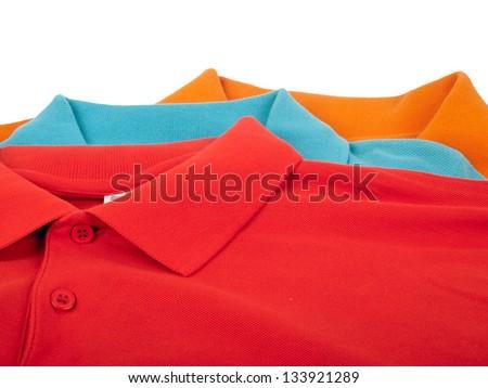 pile of man polo shirts isolated on white background - stock photo