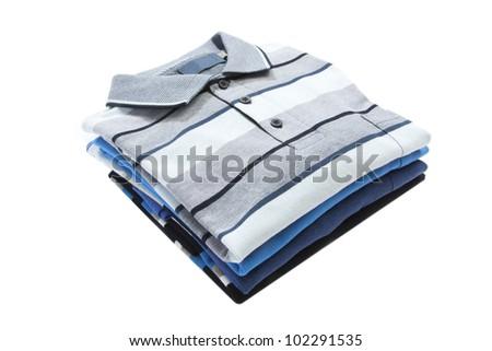 Pile of man polo shirts on white - stock photo