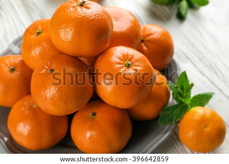 Pile of mandarin on light wooden background - stock photo