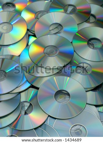 Pile of Many CDs or DVDs - stock photo