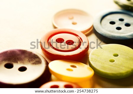 Pile of many coloured buttons as wallpaper - stock photo