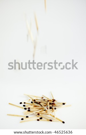 Pile of Matches, with matches falling down, white background - stock photo