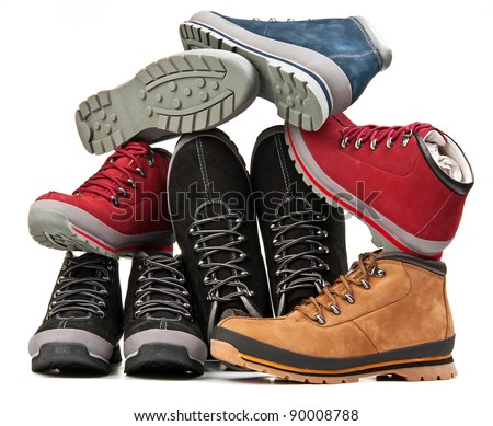 Pile of men and women boots over white background - stock photo