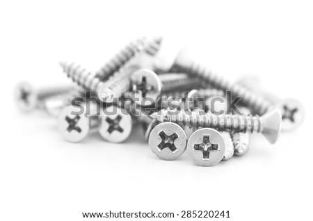 Pile of metal screw on white background. - stock photo