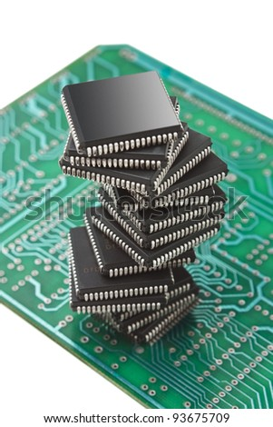 pile of microchips on a printed circuit board isolated on white background - stock photo