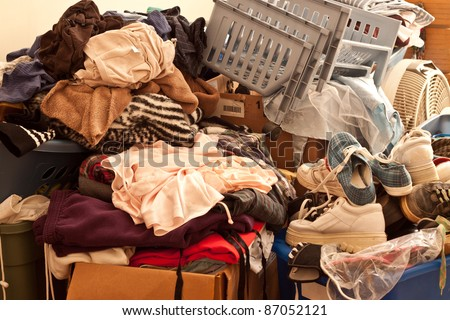 Pile of misc items stored in an unorganized fashion in a room - stock photo