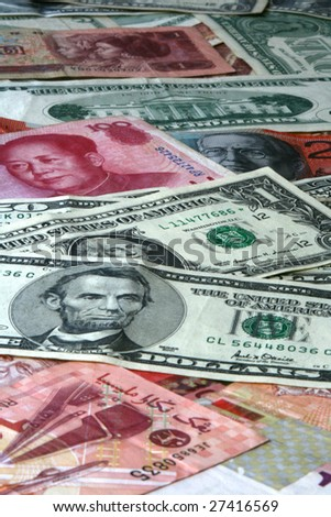 Pile of mixed money. American, Chinese, Australian and Malaysian - stock photo