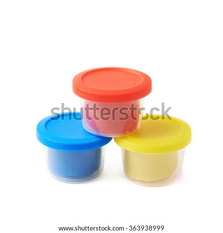 Pile of modeling clay boxes isolated - stock photo