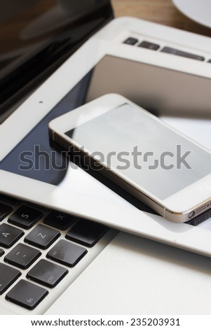 pile of modern computer devices  - laptop, tablet and phone close up - stock photo