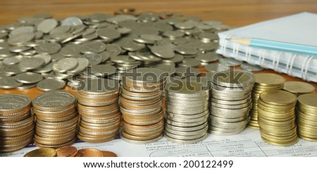 Pile of money, book accounting and billing costs put on the table.                             - stock photo