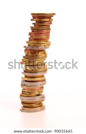 Pile of money in a studio setting over white