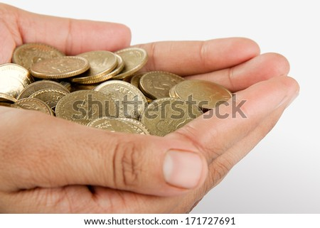 Pile of money (indian coin ) in hand isolated on white background