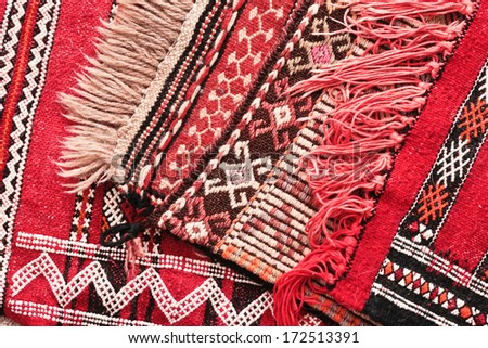 Pile Of Moroccan Kilim Rugs As A Background Stock Photo