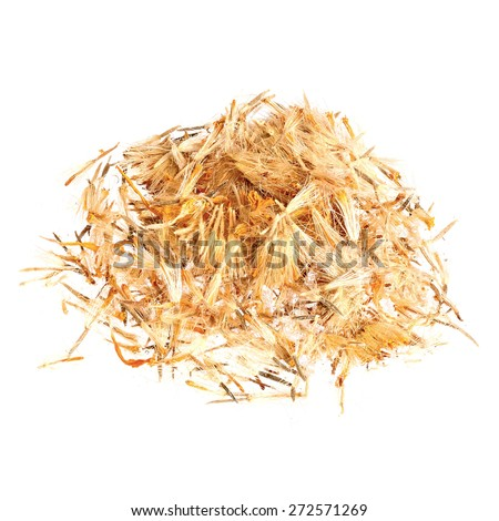 Pile of Mountain arnica, Arnicae flos isolated on white. - stock photo