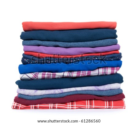 Pile of multicolored casual clothes on white background. - stock photo