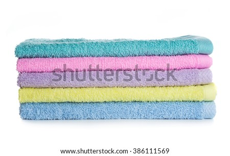 Pile of multicolored towels isolated on white background - stock photo