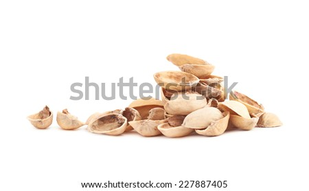 Pile of multiple pistachio shells isolated over the white background - stock photo