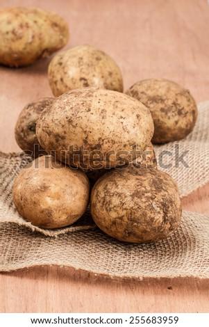 Pile of multiple potatoes - stock photo