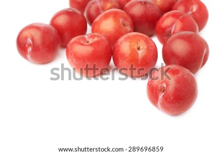 Pile of multiple red victoria plums isolated over the white background