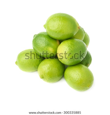 Pile of multiple ripe green limes, composition isolated over the white background - stock photo
