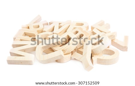 Pile of multiple wooden block letters isolated over the white background - stock photo