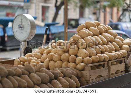 pile of new and old potatoes for sale to the market - stock photo