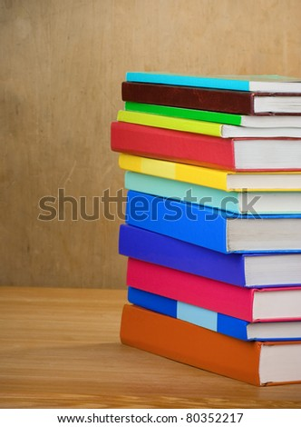 pile of new books on wood texture - stock photo