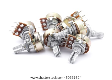 Pile of new potentiometers isolated on white