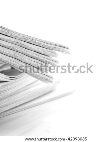 pile of news papers on white background - stock photo