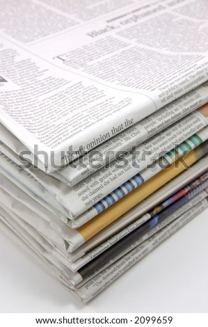 Pile of newspaper in isolated background